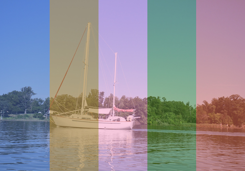 A boat out on the water with the image divided up into shades of blue, tan, purple, green and red