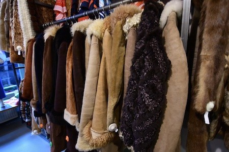 A rack of worm coats hanging up at a store