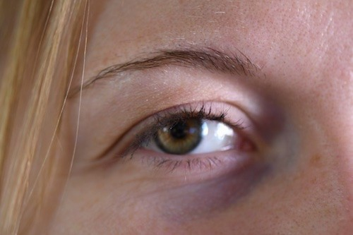 Close up of a blond haired girl's hazel eye