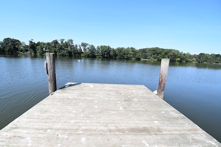 A wooden dock looking out into a body of water