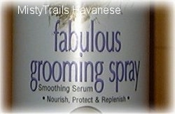 Close up - A bottle with the words - fabulous grooming spray Smoothing Serum Nourish, Protect and Replenish.