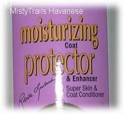 The label of a bottle of moisturizer that reads - moisturizing coat protector & enhancer Super Skin & Coat Conditioner