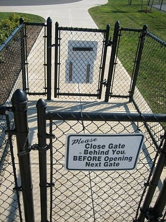 The gates that at the entrance of a Dog Park.