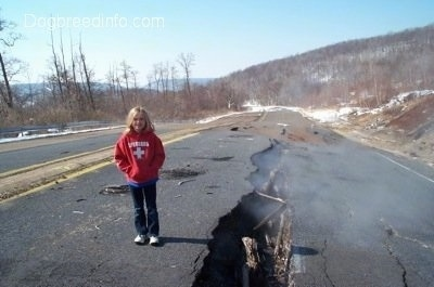 Amie standing next to the steaming crack in Highway 61