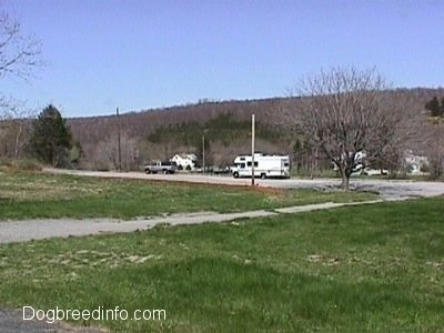 A Camper, A truck and the last houses on the other side of the road