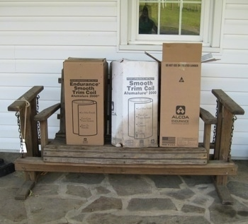 Wooden porch glider with three boxes on top of it