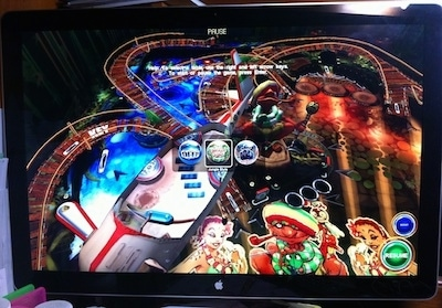 A pinball game on a large computer screen.
