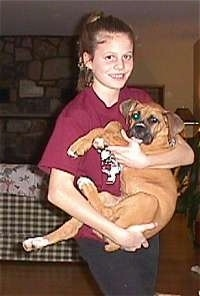 Brittany holding Allie the Boxer Puppy in her arms