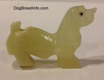 The right side of a stone Basset Hound figurine.