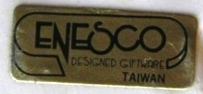 A tag with the words - Enesco designed giftware Taiwan.