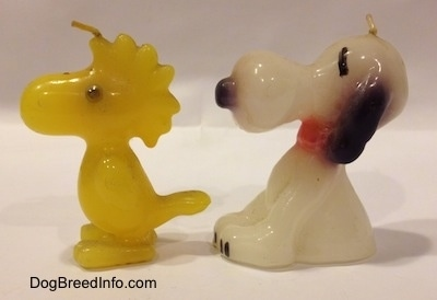 The left side of a Snoopy and Woodstock 1970s candle set.