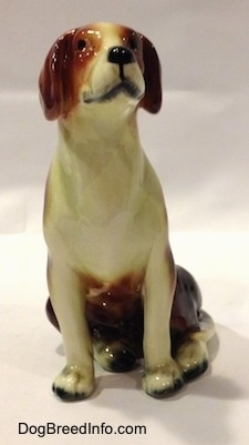 A black, brown and white porcelain Beagle figurine. The figurine has great face details.