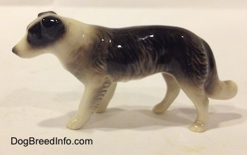 The left side of a Retired Hagen-Renaker black with white Border Collie style 1 figurine. The figurine is very glossy.