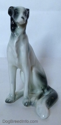 A white with black vintage Borzoi figurine. The figurine has detailed chest hair.