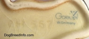 Close up - The underside of a Boxer puppy figurine. On the underside the logo of Goebel W. Germany and next to it is the engraved numbers - CH 567.