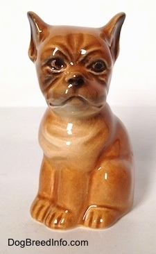 A brown Boxer puppy figurine. The figurine has black circles for its eyes.