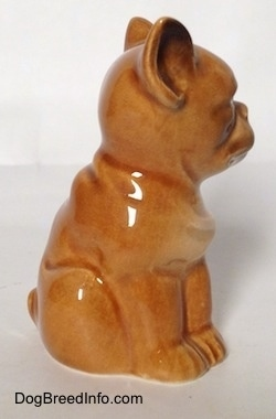The right side of a brown Boxer puppy figurine. The figurine is all one segment.