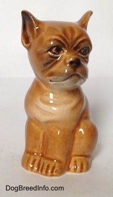 A brown Boxer puppy figurine. The figurine has very light details.