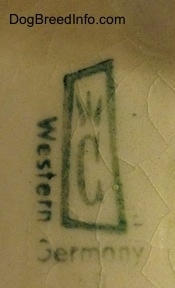 Close up - The stamp of a Contendorf Porcelain Factory on the bottom of a figurine.