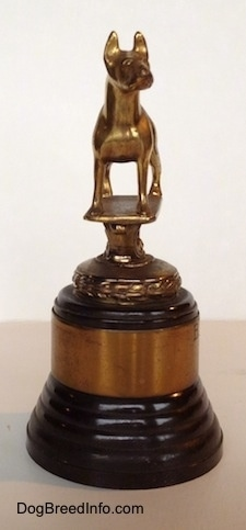 The left side of a Bull Terrier Club trophy that has a golden Bull Terrier statue at the top.