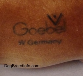 The underside of a Bull Terrier figurine that has the logo of Goebel W.Germany.