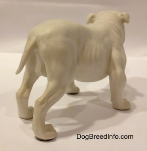 The back right side of a white bisque porcelain Bulldog figurine. The figurine has yet to be painted.