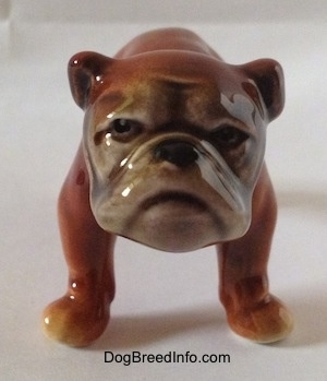 A brown Bulldog figurine. The figurine has detailed eyes.