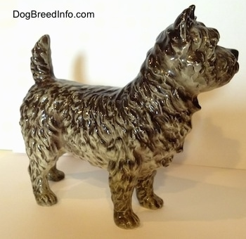 The right side of a black and white Cairn Terrier figurine. The figurine has detailed hair.
