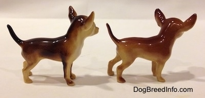 The right side of two different looking ceramic Chihuahua figurines. The figurines are very glossy.