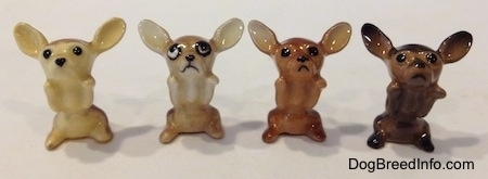 Four different variations of a Chihuahua figurine in a begging position.