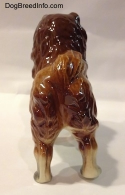 The back of a porcelain Chow Chow figurine. The figurine is glossy.