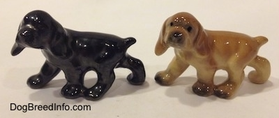 The left side of two different ceramic Cocker Spaniel puppy figurines. They are very glossy.