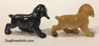 The right side of two different ceramic Cocker Spaniel puppy figurines. They are very glossy.