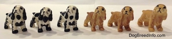 The front right side of six color variations of a Cocker Spaniel figurine. They have basic eyes.