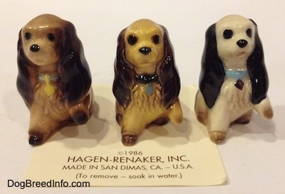 Three different ceramic Cocker Spaniel puppy figurines. The figurines have very detailed hair brushings.