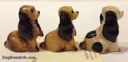 The right side of three different Cocker Spaniel puppy figurines. The ears have light details.