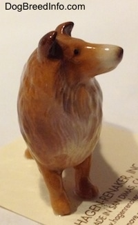 A brown with white Collie dog figurine.