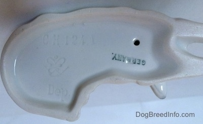 The underside of a Collie dog figurine. On the underside there is a Goebel crown mark, the word - Germany - and the engraved letter/number combination - CH1241.
