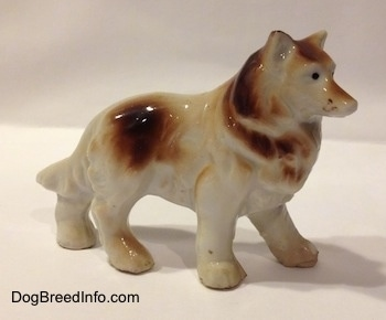 The right side of a brown and white porcelain Rough Collie figurine. The figurine has paw details.