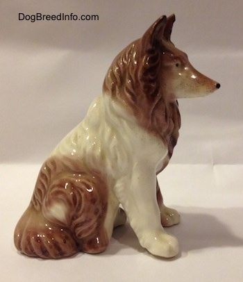 The right side of a brown and white porcelain Rough Collie figurine that has fine hair details.
