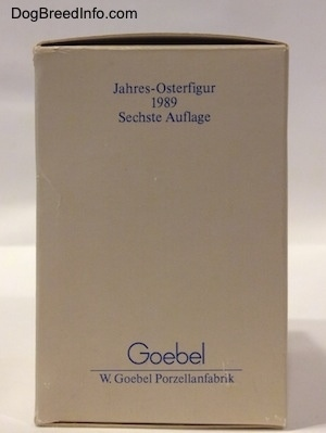 The back of a rectangular box with the words - Figurine de Paques de l'Annee 1989 Sixieme Edition - at the top. At the bottom of the box are the words - Jahres-Osterfigur 1989 Sechste Auflage.