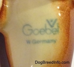 The underside of a Dachshund figurine that has a Goebel W.Germany stamp on it.