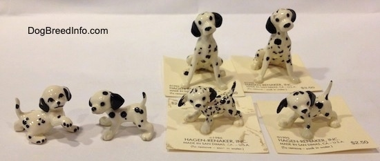 There are six hand painted Dalmatian figurines. Four are puppies and two are full grown Dalmatians.