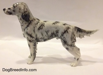The left side of a white and black English Setter porcelain figurine.