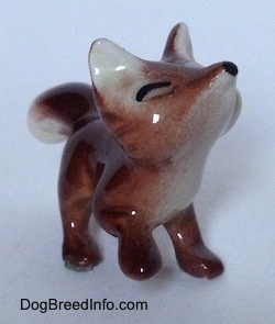The front right side of a Baby Fox figurine. The chest of the figurine is white.