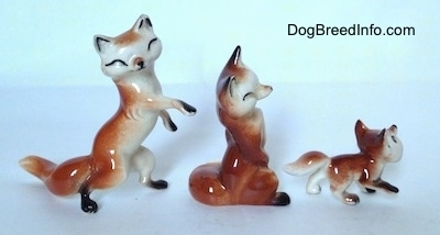 The right side of three different Fox figurines. Each figurine has a white chest.