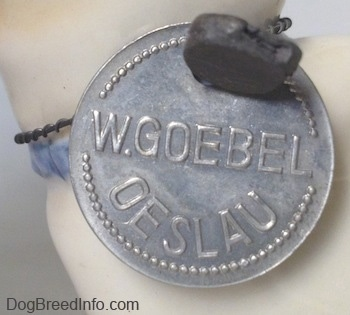 Close up - On a silver medallion it has the words - W.Goebel Oeslau - engraved into it.
