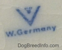 Close up - The underside of a white figurine with the full bee inside the v logo under that is the words - W.Germany.