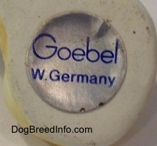 "The silver and blue round sticker with the name ""Goebel"" with W. Germany"" below it."