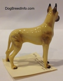 The right side of a tan with black Great Dane figurine. The figurine has a detailed body.